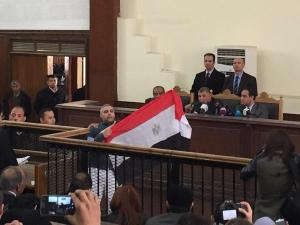Fahmy holding up Egyptian flag. From @reportedly.