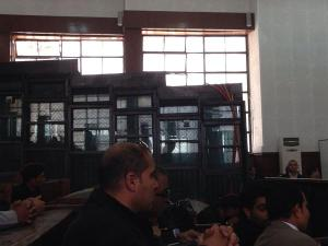 Fahmy & Mohamed enclosed in cage.  From @reportedly.
