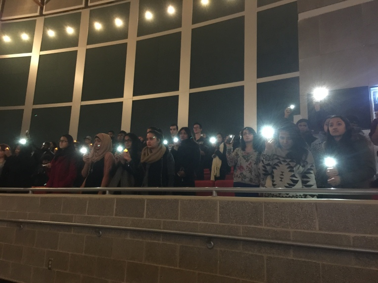 Students holding up their cellphones during the Chapel Hill Candlelight Vigil at Stony Brook University.