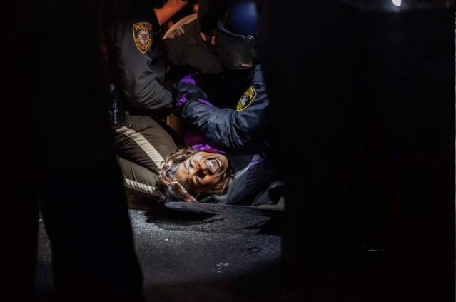 Dasha Jones, 19, is arrested during a protest before the  verdict was made against Darren Wilson, Nov. 20, 2014. Photo by Barrett Emke.
