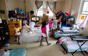 """""""The family's room is the scene of debilitating chaos: stacks of dirty laundry, shoes stuffed under a mattress, bicycles and coats piled high."""""""