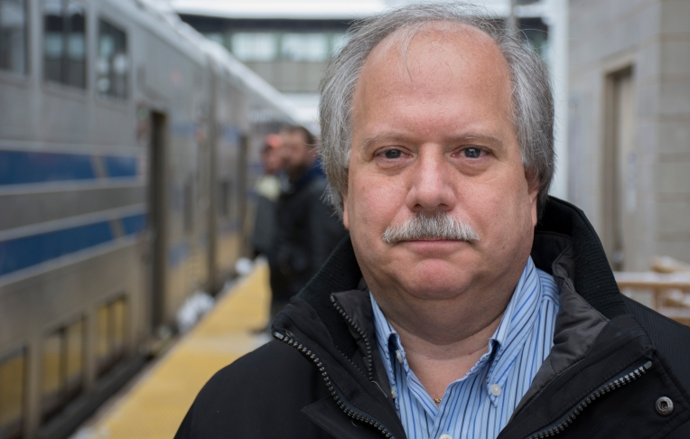 """Robert Federici, an employee at Fairfield Mortgage and a monthly-pass buyer, said his four- or five-day commute via LIRR to Penn Station from Huntington will have him feel the pinch in his pocket. The increase in fares cannot be legitimized, he added. if there is not a clear reason for the increase. Federici said he is tired of """"the MTA squeezing commuters for money every couple of years,"""" especially when there is no clear commuter-gain from it. Photo by JD Allen (March 2, 2015)"""