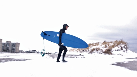 NYC female surfer and career woman Jee Mee Kim makes her way to the waves at Rockaway Beach. Photo credit: Elisa Bates.