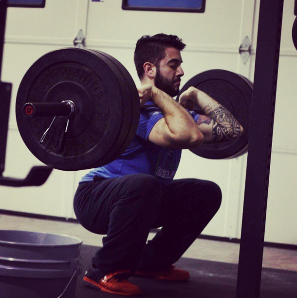 Peter Iaboni, 25, front squatting five sets of three reps at 225 lbs in the gym.